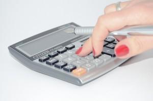 Hand on calculator financial education