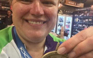 Rachel with Gold Medal after community bike ride
