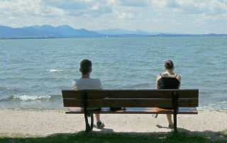 divorce couple sat on bench