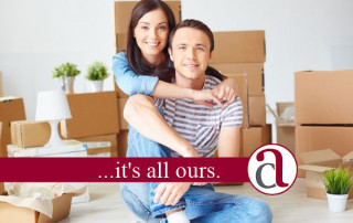 young couple with boxes in new build home